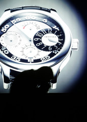 A man passes a showcase of Swiss watchmaker Chopard on the pressday of the watch fair Baselworld in Basel