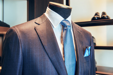 A luxury business suit in set with blue necktie