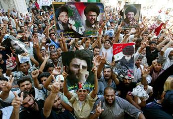 Supporters of radical Iraqi Shi'ite leader Moqtada al Sadr chant inside Najaf's Imam Ali shrine.