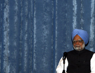 India's Prime Minister Manmohan Singh attends a gathering in New Delhi