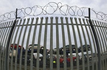 Cars are loaded onto a transporter at the PSA Peugeot Citroen Ryton plant in Coventry