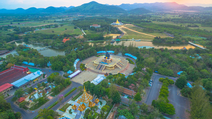 sunset at Huay Mongkol temple.the black Buddha statue name Luang Phor Tuad is the one buddhist amulets famous in Thailand