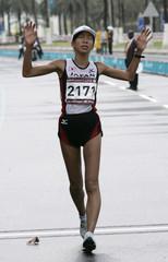 Japan's Sakakura celebrates during women's 20km walk at Asian Games in Doha