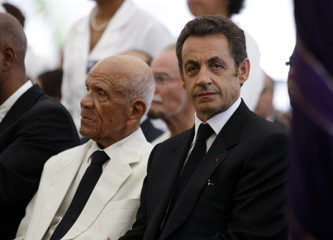 France's President Sarkozy and Aliker pay respects to French poet Cesaire during a three-day funeral memorial at Fort de France French Antilles