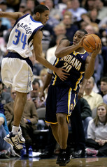 Pacers guard Jones tries to pass against Mavericks Devin Harris during NBA action in Dallas