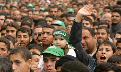Palestinian supporters of Hamas attend a rally to celebrate winning municipal elections in Jabalya refugee camp in northern Gaza Strip