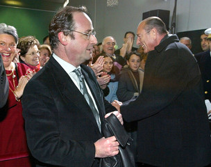 French President Jacques Chirac (R) and Socialist party First Secretary Francois Hollande (L) arrive..