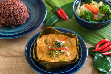 steamed fish with curry paste and berry rice