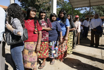 Paraguayan Maka Indians stand on line with other citizens to vote during general elections in Comunidad Maka