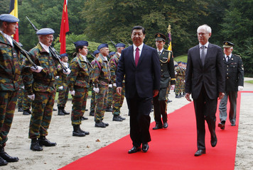 China's Vice President Xi Jinping and Belgian PM Van Rompuy review troops in Brussels