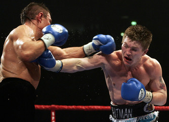 Britain's Hatton lands a punch on Australian Tszyu during their IBF World Championship title fight in ...