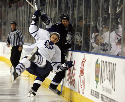 Lightning's Kuba draws a penalty for holding against Maple Leafs' Ponikarovsky in Tampa