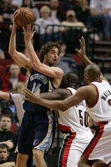 Memphis Grizzlies' Pau Gasol from Spain is defended by Portland Trail Blazers' Zach Randolph and Jamaal Magloire during their NBA basketball game in Portland