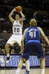 Spurs Manu Ginobili shoots over Mavericks Dirk Nowitzki during NBA game in San Antonio
