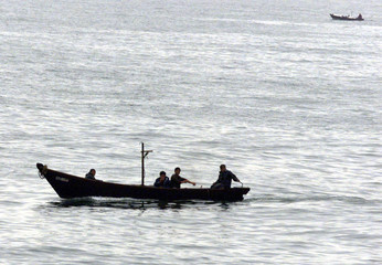 NORTH KOREANS SAIL NEAR THE VILLAGE OF KUMHO ON NORTH KOREA'S EASTERNCOAST.