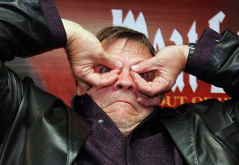 US rock and roll singer Meat Loaf gestures during news conference in Hong Kong
