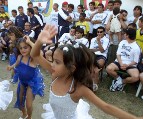 LITTLE GIRLS DANCING RUMBA FOR CHILES SOCCER TEAM.