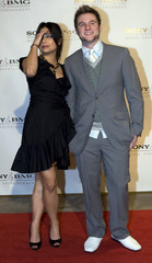 Singer Blake Lewis and a companion pose at the Sony BMG Post Grammy Party in Beverly Hills