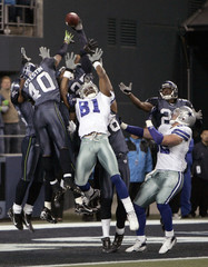 Seahawks Celestin knocks ball away from Cowboys Owens on the last play of the game in their NFC Wild Card NFL playoff game in Seattle