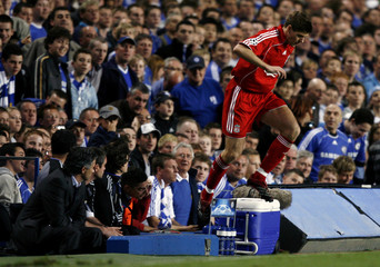 Liverpool's Gerrard jumps onto the pitch during a Champions League soccer match in London