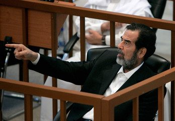 Former Iraqi leader Saddam addresses the court during the third day of his trial in Baghdad