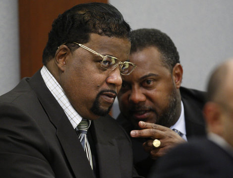 Stewart, one of two of Simpson's co-defendants, and his attorney, Louisiana state Sen. D. Jones confer during a preliminary hearing in Las Vegas