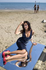Italian actress Cucinotta poses on the beach during a photocall at the 66th Venice Film Festival