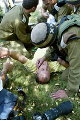 Israeli journalist Itzik Saban, gets first aid after he was shoot at by a Palestinian gunman at the ...