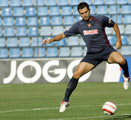 Portuguese soccer player Pauleta controls the ball during training session, Azores.