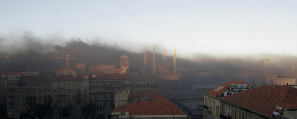 Smoke from burning tyres rises above the Beirut downtown