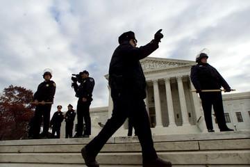 POLICE KEEP DEMONSRATORS OFF SUPREME COURT STEPS.