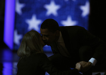US Democratic presidential candidate Obama kisses an audience member at the CNN/Los Angeles Times Democratic presidential debate in Hollywood