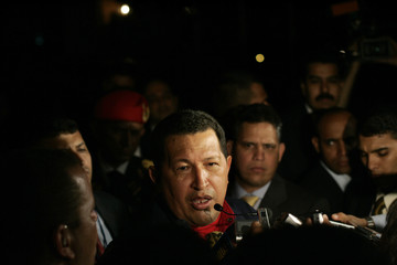 Venezuela's president Chavez speaks to the media during his arrival at a hotel in Santo Domingo