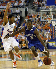 University of Kentucky guard Bradley drives towards the basket as University of Florida guard Hodges tries to stop him in the second  period of NCAA basketball game in Gainesville