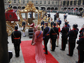 Crown Prince Willem Alexander and his wife Princess Maxima watch Queen Beatrix salute the Standard as they leave the Hall of Knights in The Hague