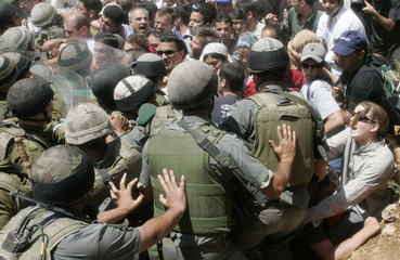 Palestinian, Israeli and foreign demonstrators scuffle with Israeli soldiers in Artas