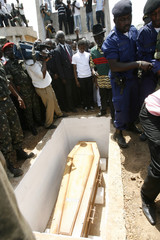 The coffin of Guinea-Bissau President Vieira is seen in grave during burial ceremony at main cemetery of Bissau