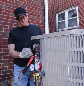HVAC Technician Repairing Air Conditioning Unit