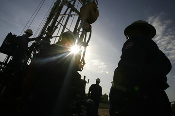 Oil workers are seen at an oil field in Cabimas in Venezuela's western state of Zulia