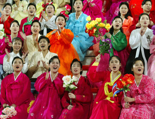 North Korean women in traditional dresses support their team during World Cup 2006 qualifier match ...