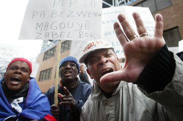 MONTREAL HAITIANS TAKE TO STREETS IN SUPPORT OF HAITIAN PRESIDENT ARISTIDE.