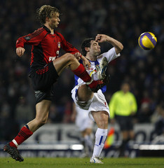 Bayer Leverkusen's Rolfes clashes with Blackburn Rovers' Dunn during their UEFA Cup first knockout round match in Blackburn