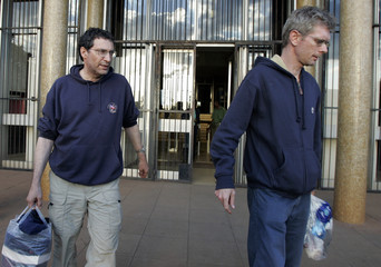 New York Times' Bearak and British journalist Bevan arrive at the magistrates court for a bail hearing in the capital Harare
