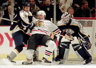 BLACKHAWKS AMONTE TIED UP BY PREDATORS HULSE IN CHICAGO.
