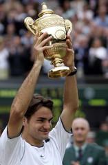 Switzerland's Roger Federer lifts championship trophy at the Wimbledon tennis championships in London.