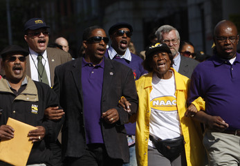 President of NAACP Dukes and other people take part in a demonstration in New York City