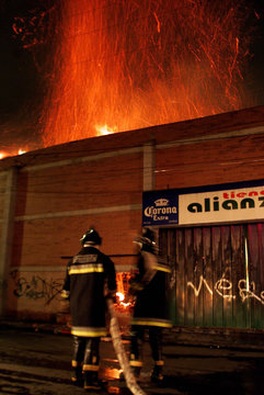 MEXICAN FIREMEN BATTLE A FIRE IN BEER AND WINE WAREHOUSE IN MEXICOCITY.