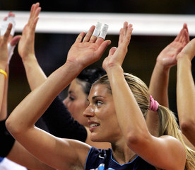 Italys Piccinini celebrates victory after their match against Kenya at the Athens 2004 Olympic Games.