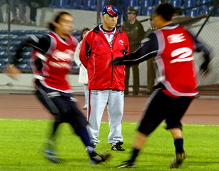 Acosta, coach of Chilean soccer team, stands during a training session in Santiago.