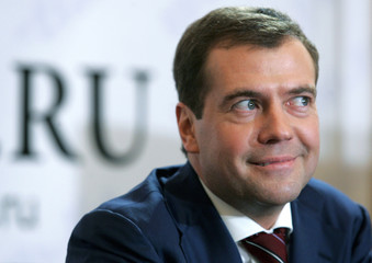 Russia's First Deputy PM Medvedev smiles during a televised internet conference in Moscow